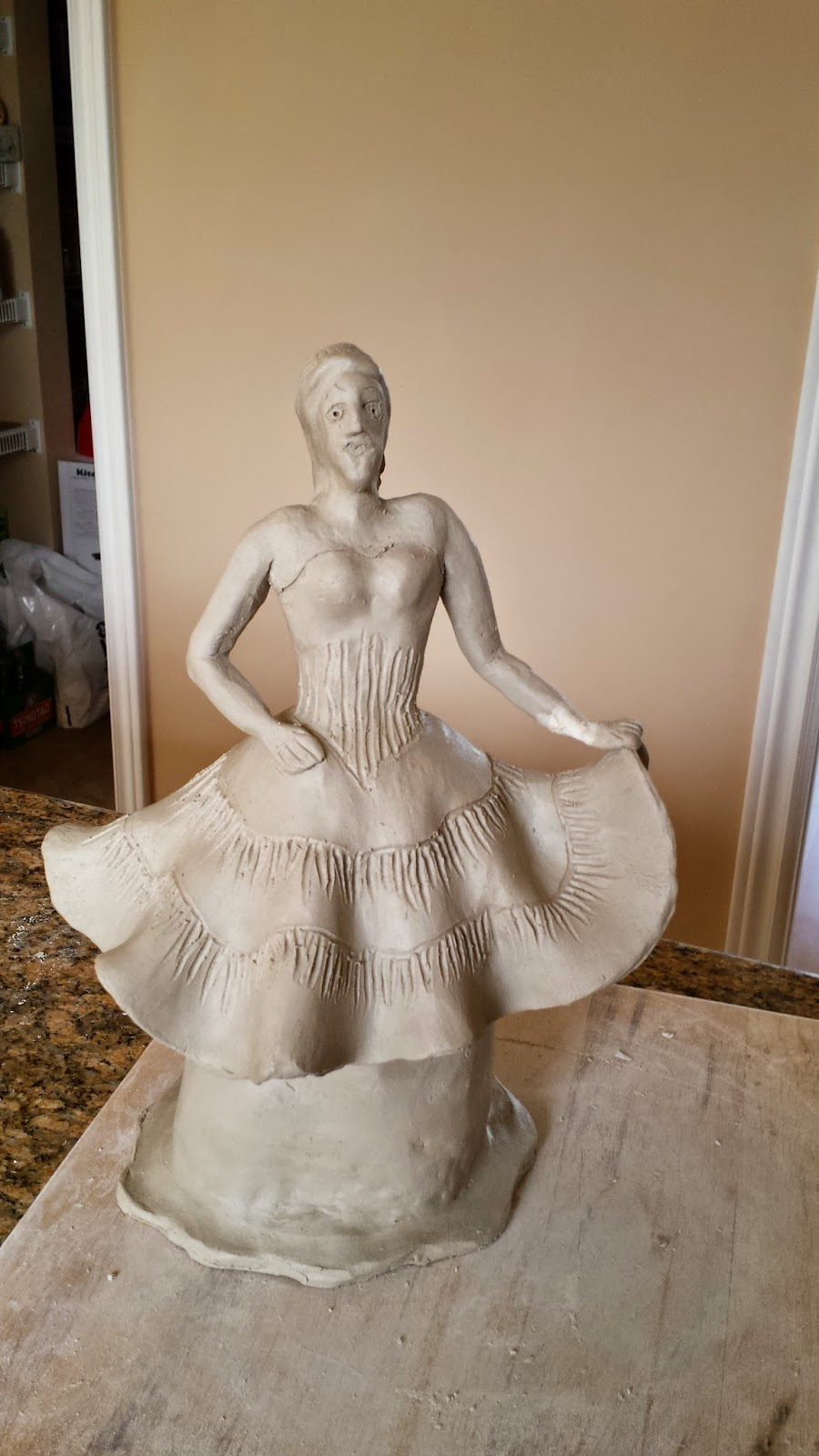 Ceramic sculptural piece - lady in ball gown - prior to raku firing.