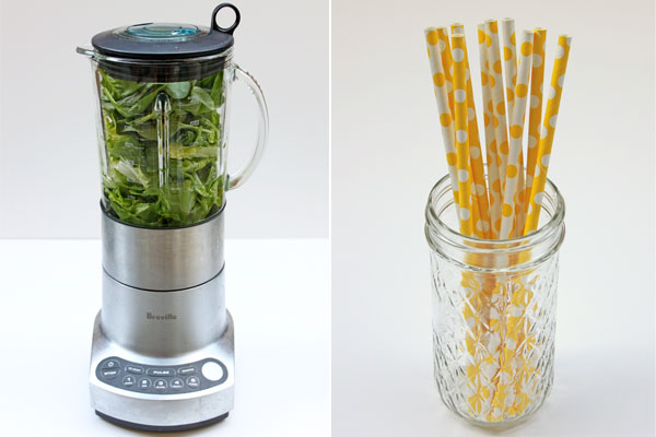 Blender with romaine lettuce and spinach, mason jar with yellow polka dot straws