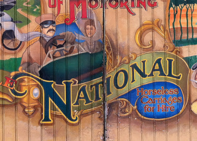 Disneyland Main Street mural National sponsor vehicles