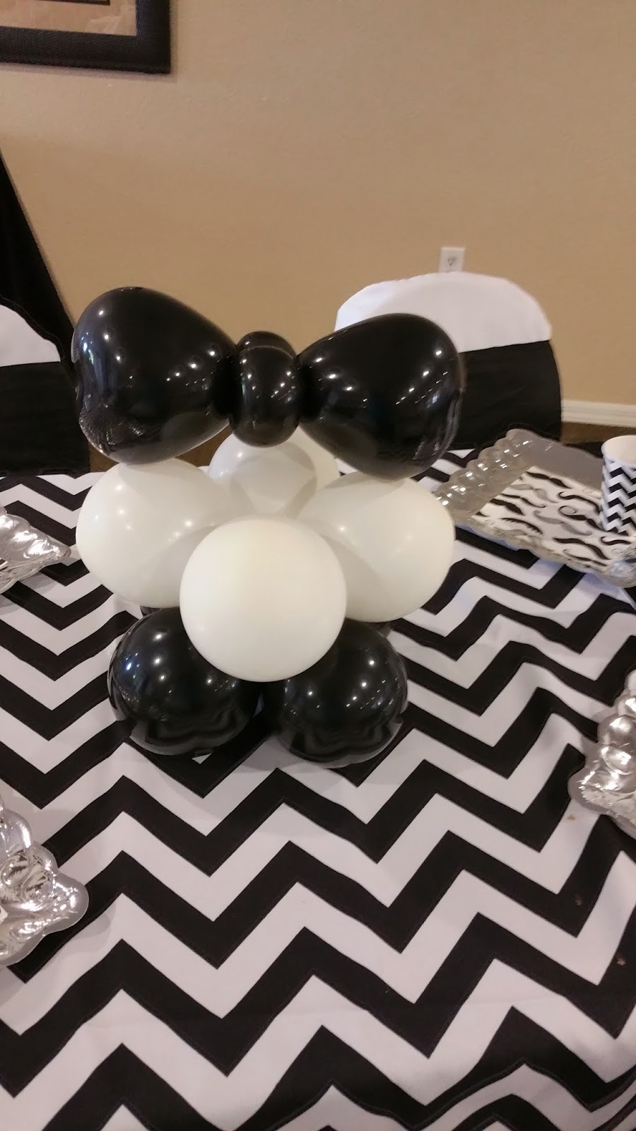 people event decorating company bow tie and mustache baby shower