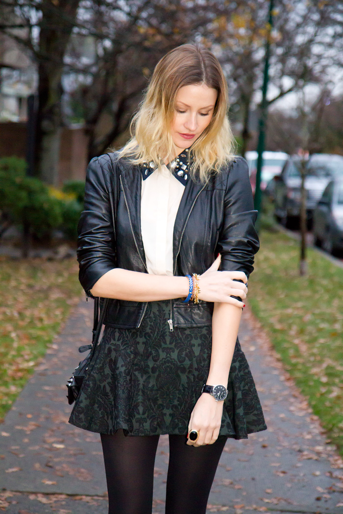 Vancouver Fashion Blogger, Alison Hutchinson, wearing Sugarlips Embedded Jewels Top, Forever 21 faux leather jacket, Zara brocade baroque skirt, Zara black ankle boots, Urban Outfitters spiked black leather bag, Stella & Dot Renegade Cluster Bracelet, True Worth Design bronze bead bracelet, and J Crew blue and gold bangle