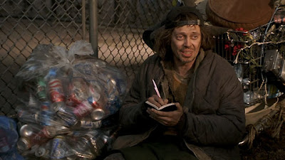 Steve Buscemi playing homeless man writing a book in Big Daddy cans introspective hobo