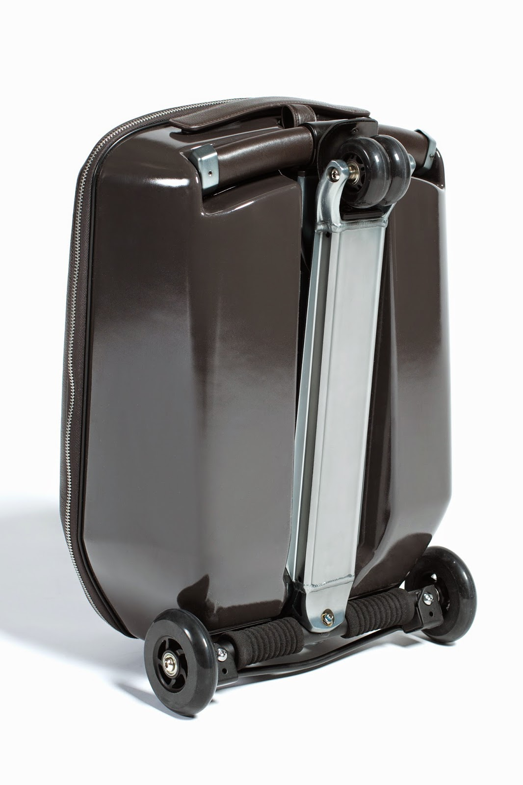 Life through preppy glasses travel in style with for Motorized ride on suitcase