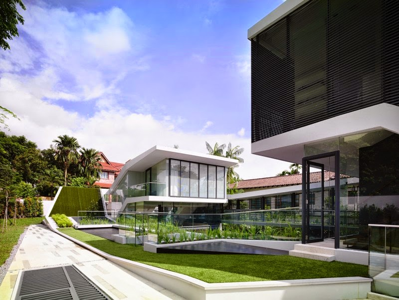 Singapore Contemporary House with Futuristic Green Roof slopping landscape