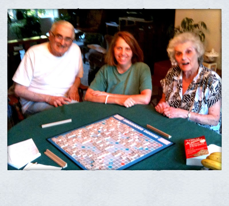 Mom, Dad and I playing Scrabble