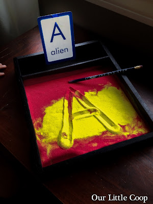 DIY sand writing tray, learn the letter A, montessori, alphabet, colored sand