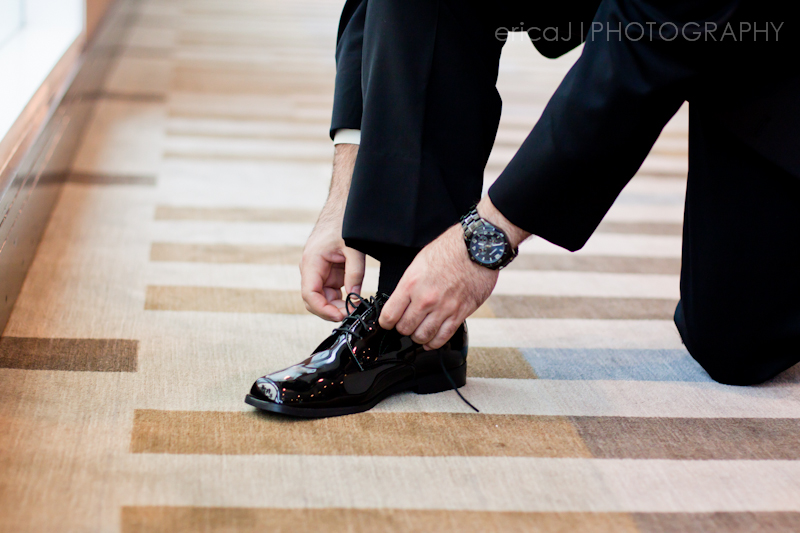 groom tying his shoe