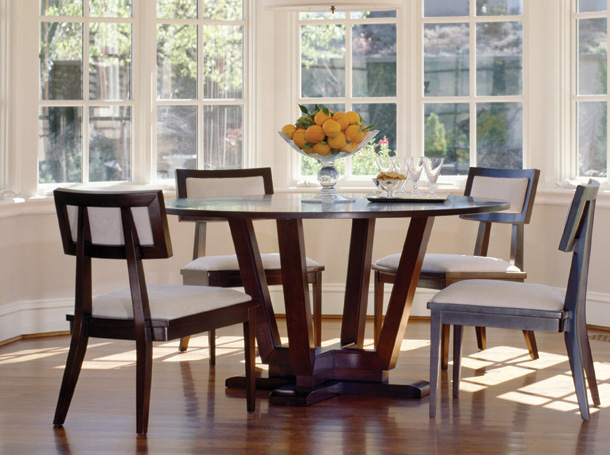 Modern round dining table designs an interior design for Dining table design ideas