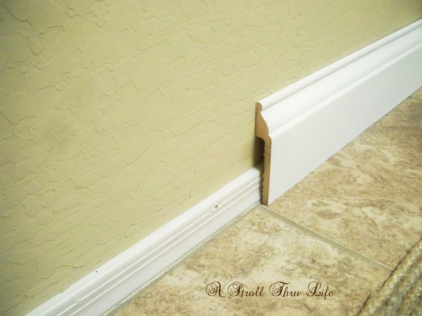 A Stroll Thru Life Install Wide Baseboard Molding Over Existing Narrow Baseboard