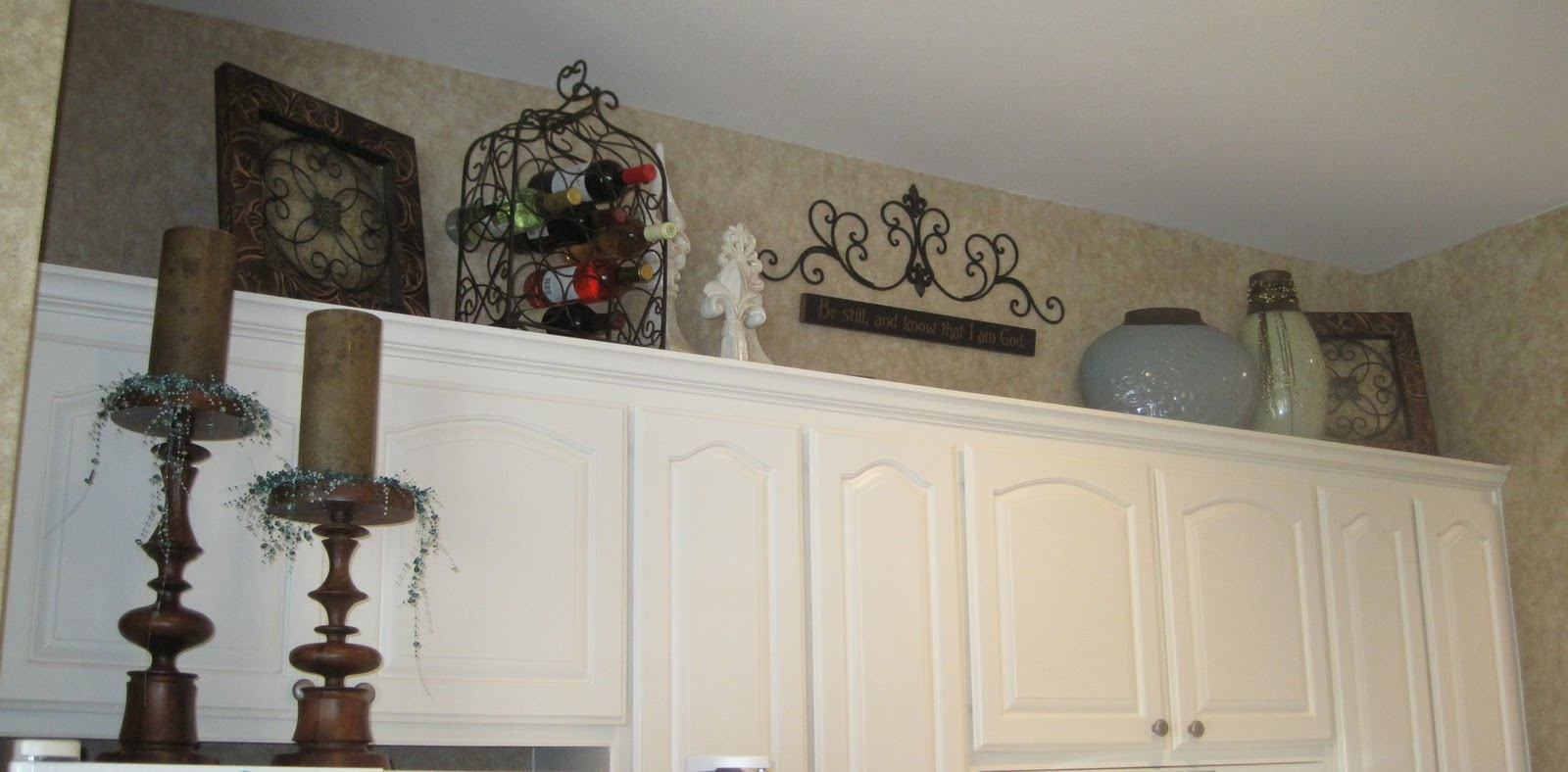 Decorating above my cabinets ideas kitchen cabinet for Above cupboard decoration ideas