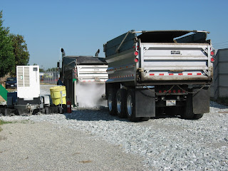 On leaving the work area, the truck receives a spray cleaning to prevent the trackout of dust or mud onto neighborhood streets.