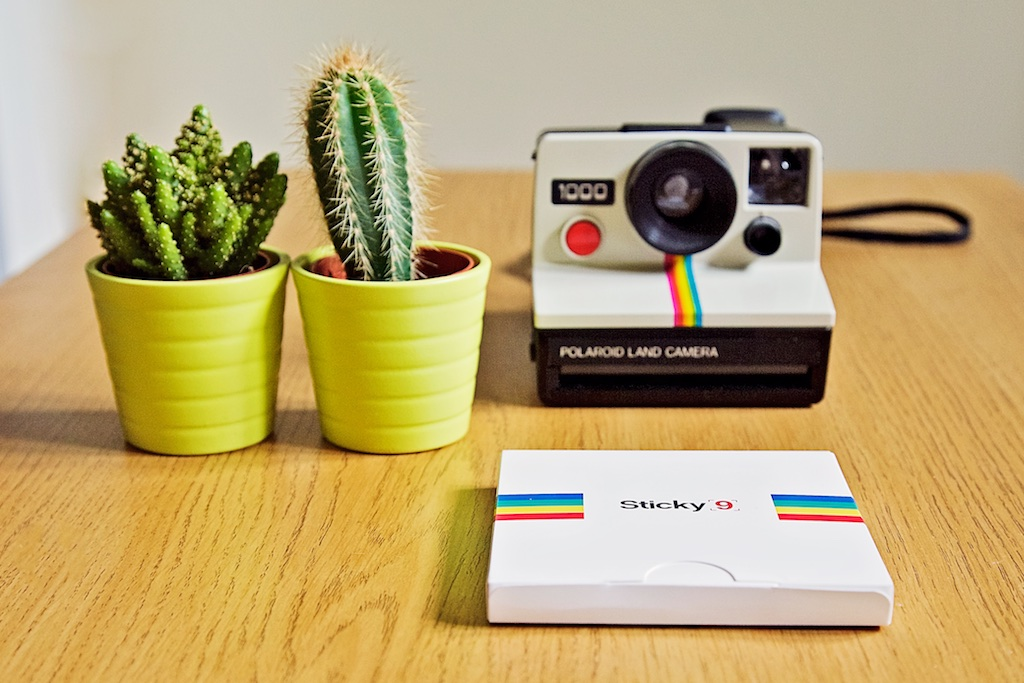 Polaroid land camera with Sticky9 print box and cacti decoration.