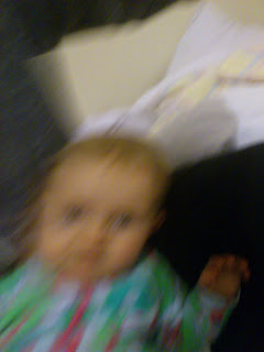 blurry photo of baby in green onesie