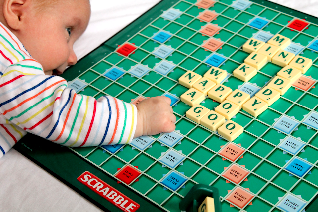 baby playing scrabble