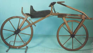"The two-wheeled, pedal-less device known as the ""draisine"""