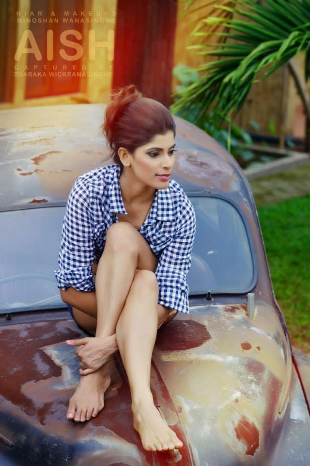 Aish Athukoralage crossed legs