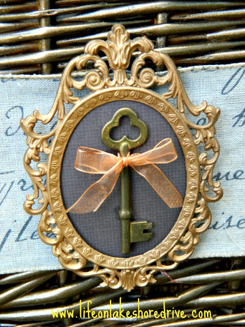 antique skeleton key on frame used to decorate wicker basket