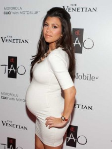 kourtney kardashian pregnant belly latest fashion trend