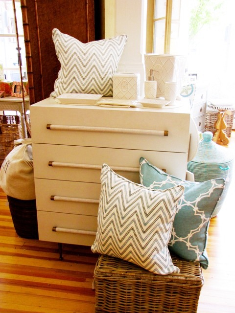 COCOCOZY Quatrefoil and Circle Chevron pillows on display near a white dresser