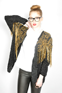 Vintage 1980's black beaded trophy jacket with gold beaded fringe details.