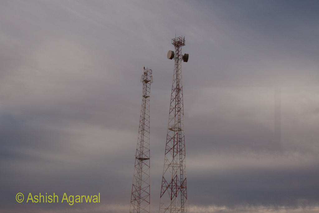 Telecom transmission towers, with a backdrop of thick clouds, on the way to Abu Simbel in Egypt
