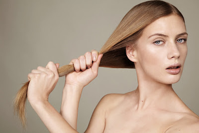 beauty photographer nyc, woman with strong hair, woman pulling hair, hair treatments