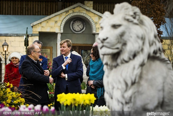Dutch King Willem-Alexander speaks with flower bulb growers during the opening of the 35th edition of 'Lentetuin Breezand' (Breezand Spring Garden) in Breezand