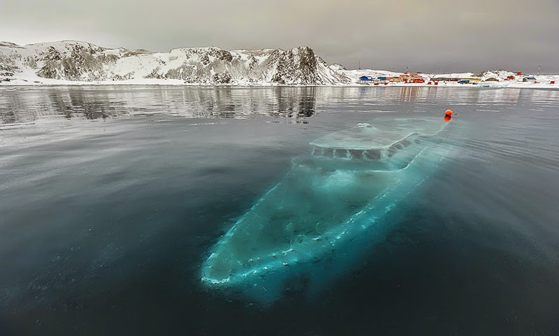 12. Sunken Yacht, Antarctica - 31 Haunting Images Of Abandoned Places That Will Give You Goose Bumps