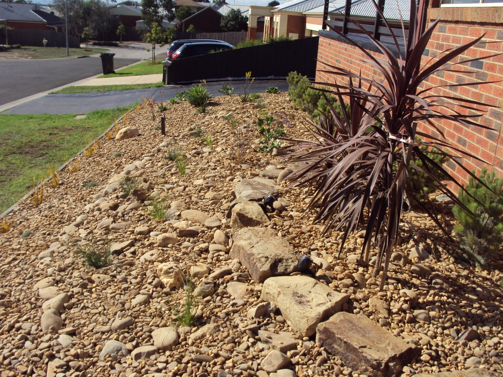 Scorpio landscaping geelong simple rock garden and path for Landscaping rocks geelong