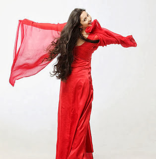 Charmi Kaurs in Red Cute Photoshoot