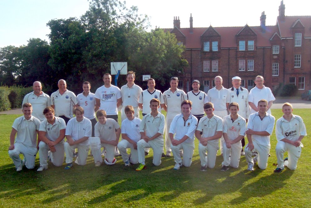 The teams from the annual Briggensians v Sir John Nelthorpe School cricket match, July 11, 2014, with the former boarding house forming a backdrop