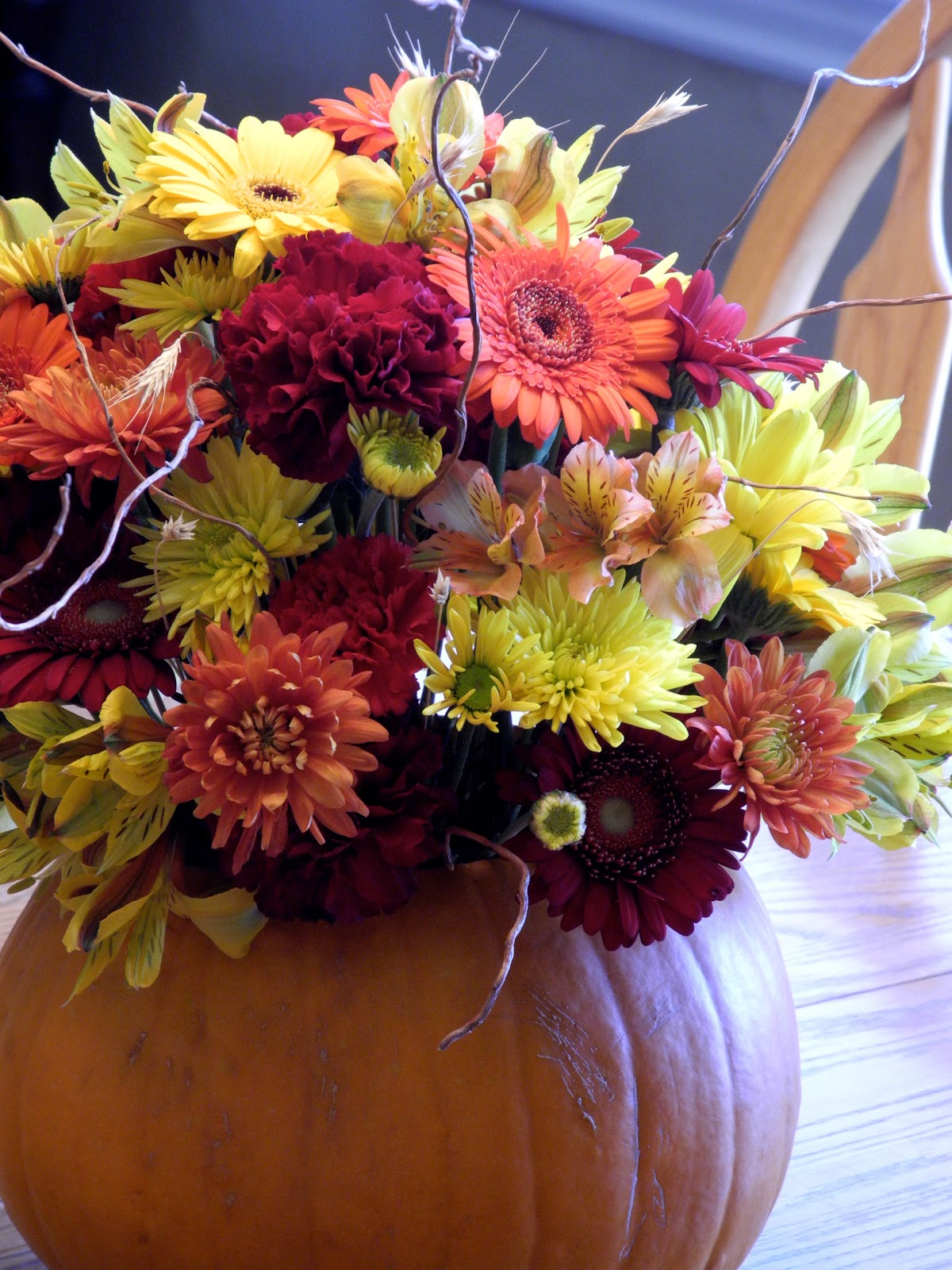 Fall Flowers And A Pumpkin