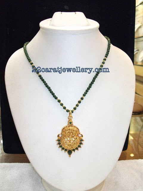 Green jade beads long chains with gold nakshi pendantslaxmi pendant checkout beautiful dark green jades beads long chainsgold small bits alternate with chain and attached with gold laxmi nakshi pendants ndant studded mozeypictures Choice Image