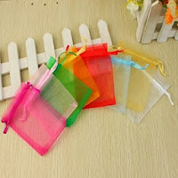http://www.specialgiftboxes.com/product/tulle-favor-bag-set-of-24/