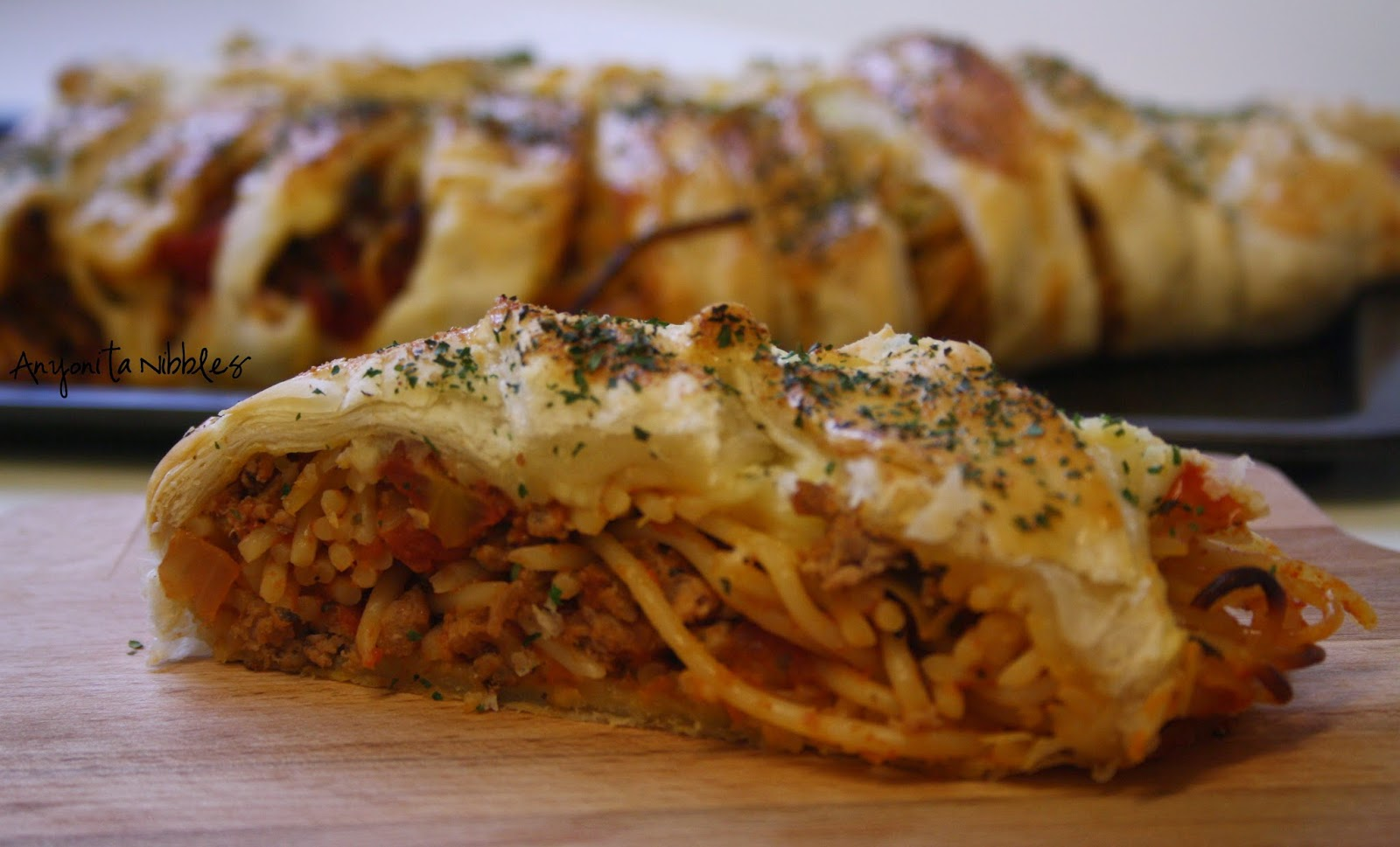 A slice of braided spaghetti loaf | Anyonita Nibbles