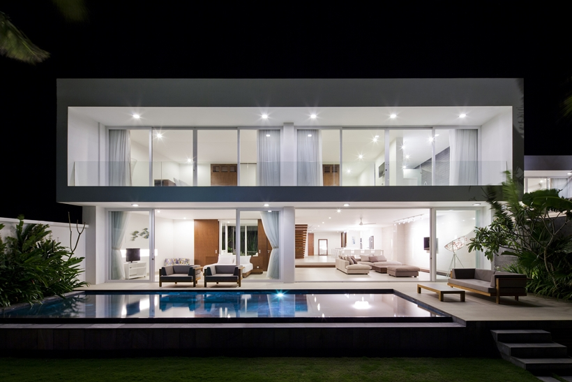 Modern beach house at night