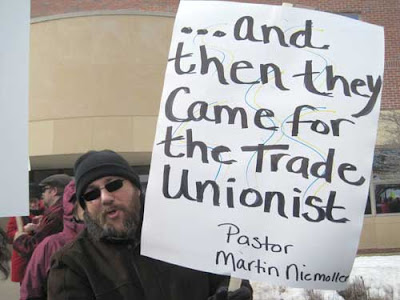 Man with sign reading Then they came for the trade unionists