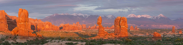 Panorama of Arches National Park with Balanced Rock Turret Arch and the La Sal Mountains