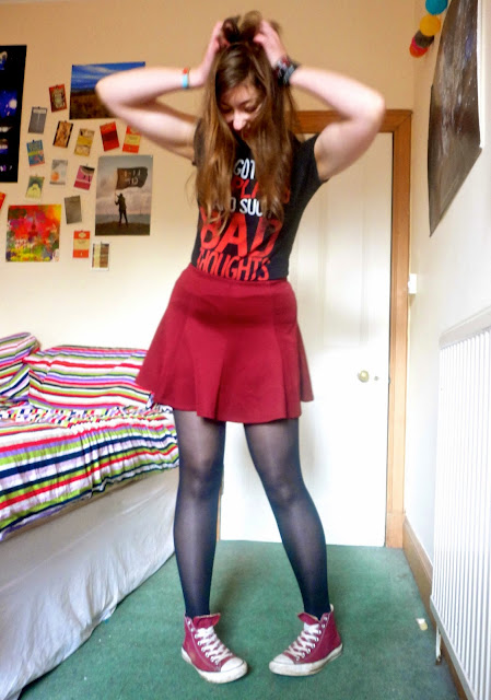 Rocker chick outfit | you me at six tshirt, red skirt and converse
