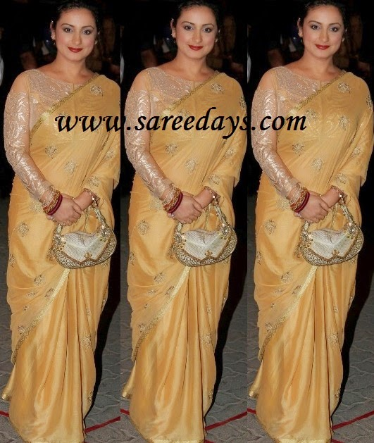 Latest saree designs divya dutta in gold colour shimmer saree checkout divya dutta in gold colour shimmer saree with zari border and paired with shimmer full sleeves with open neck pattern blouse altavistaventures Image collections