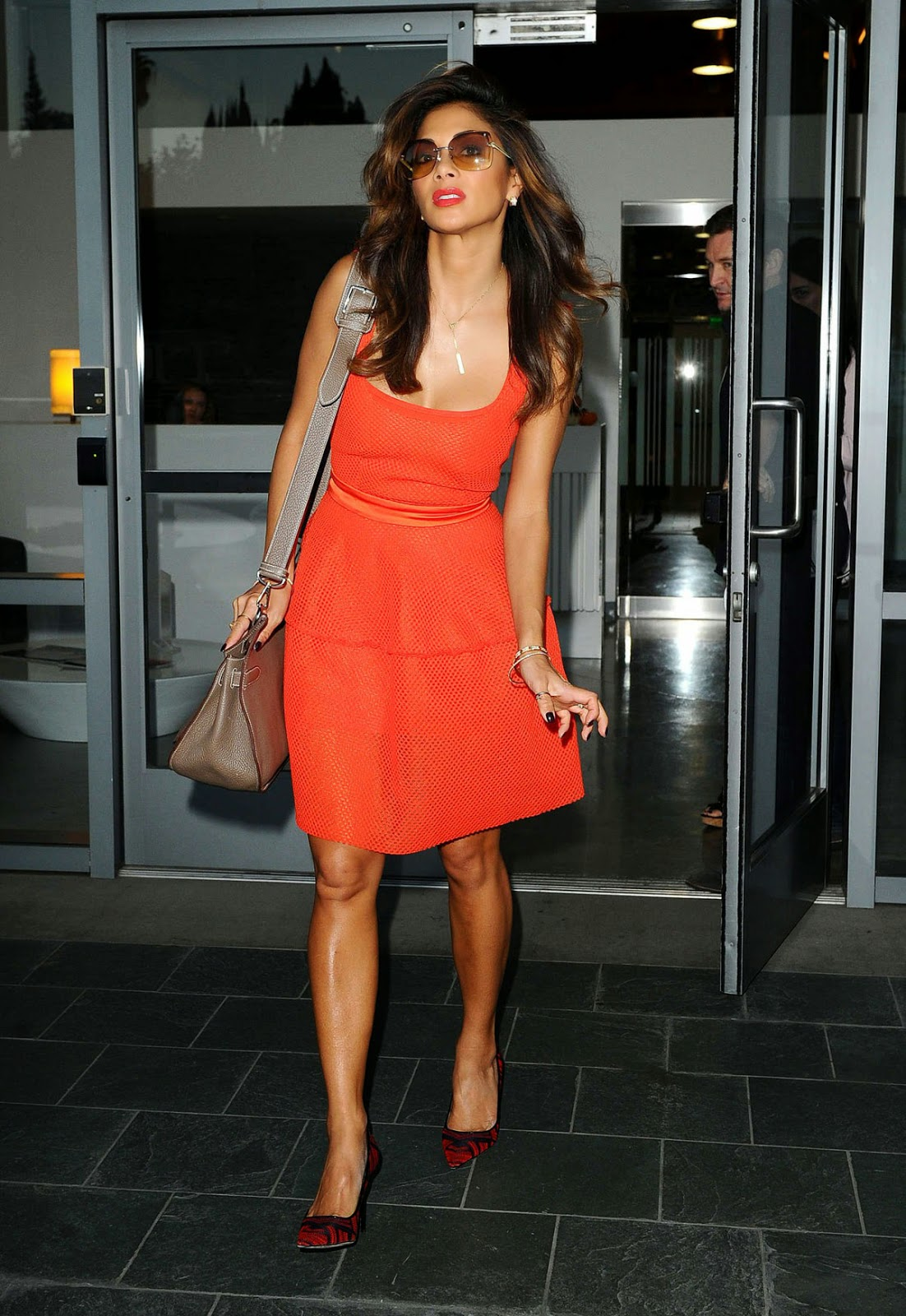 Nicole Scherzinger in orange dress at Live Nation Office pic 1