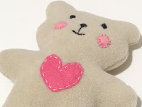 http://sewtoy.com/free-toy-sewing-pattern/how-to-sew-quickly-a-lovable-little-soft-baby-teddy-bear/