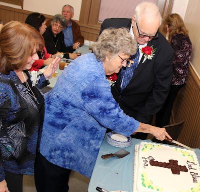 Newly professed cut a celebratory cake.
