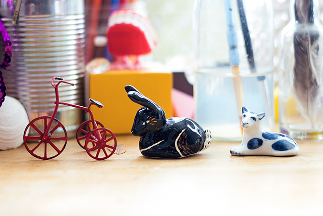 three trinkets: bicycle, bunny and cat