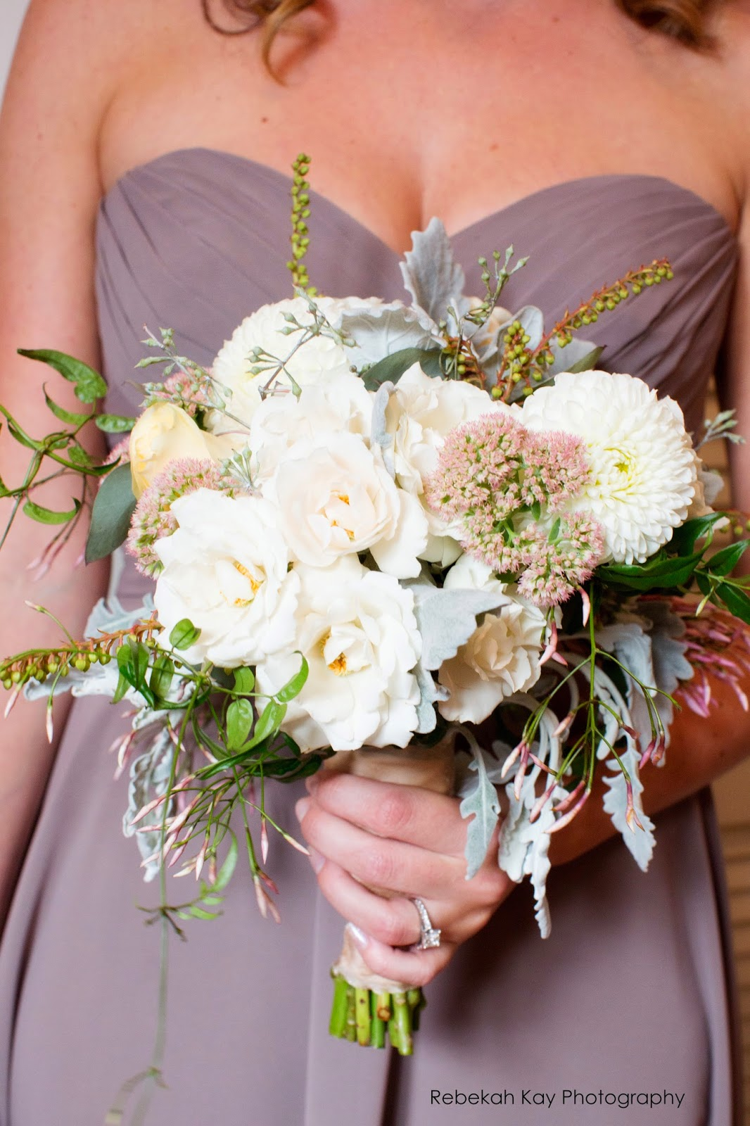 les fleurs : fall wedding : boston harbor hotel : latte bridesmaid dresses : romantic bouquets : sedum, dusty miller, dahlia, andromedia, roses : broach on bouquet stems