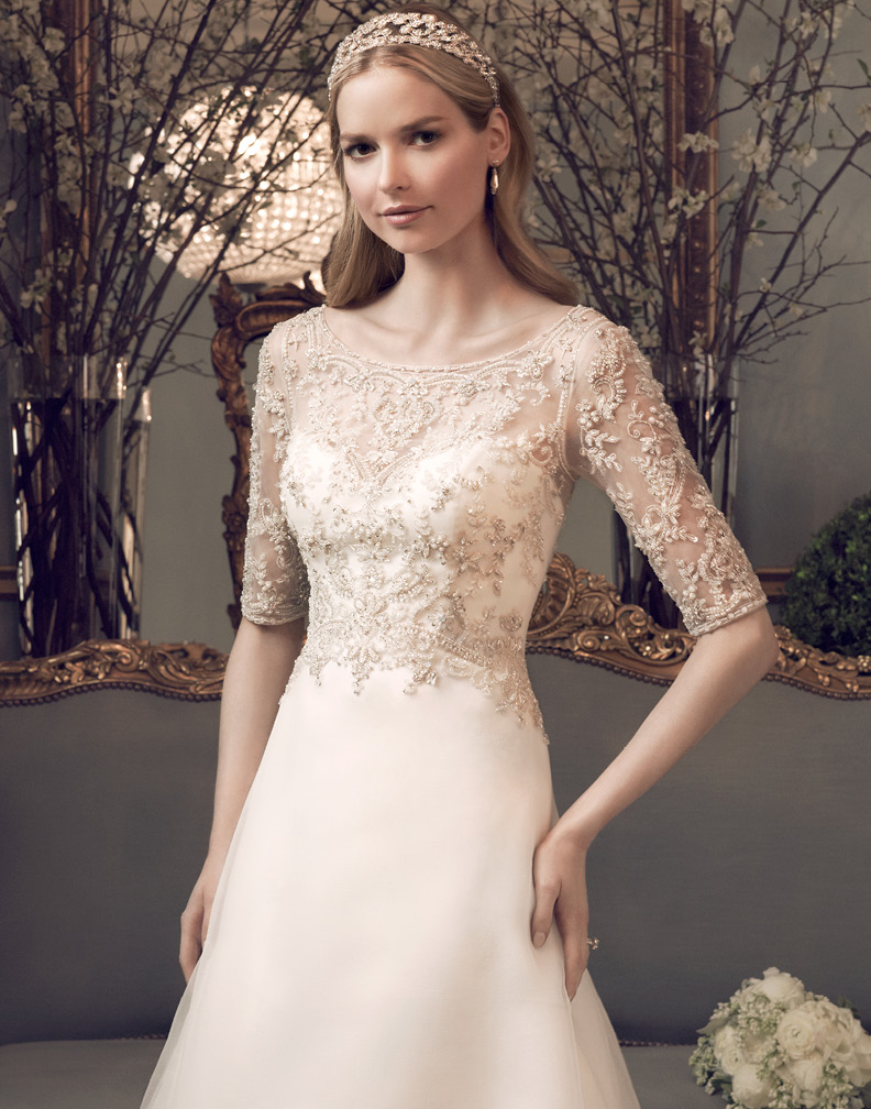 http://www.aislestyle.co.uk/sparkling-beaded-bodice-half-sleeved-slim-aline-wedding-dress-p-1688.html