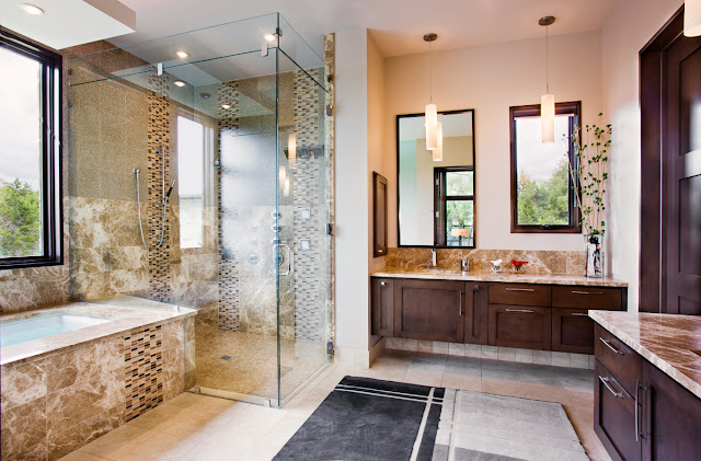 Picture of modern luxury bathroom in the Texas style wit dark wood, glass and stone