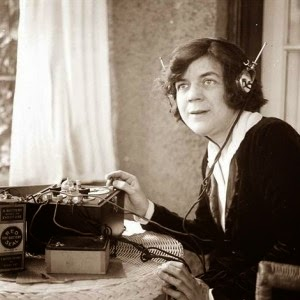 vintage lady listening into radio set