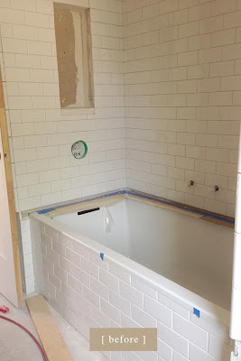 Craftsman bungalow renovation progress. Master bathroom marble tub surround. traditional bathroom.