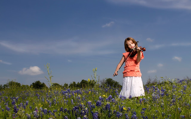 Cute Girl Playing Violin